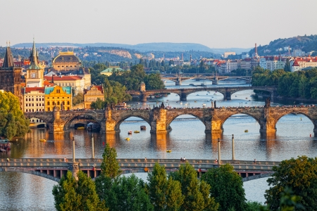 View of the Vltava River and the bridges shined with the sunset sun, Prague, the Czech Republic photo
