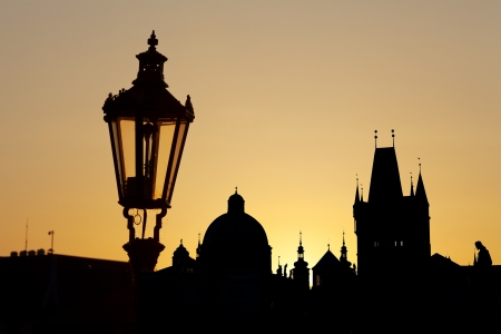 Ancient lamp in Prague against sunrise photo