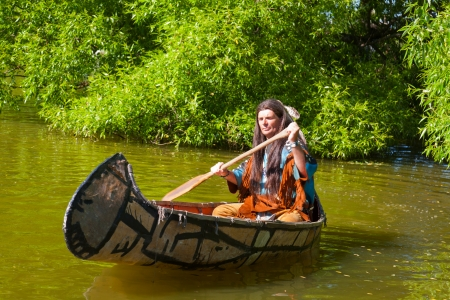 swarty: North American Indian floats down the river on a canoe