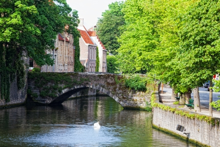 Classic view of channels of Bruges. Belgium. Medieval fairytale city. Summer urban landscape. Stock Photo - 23178610