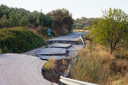 Because of the violation of technology in the construction of roads, water washed away roads and formed a failure  photo