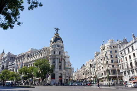 MADRID, SPAIN-SEPTEMBER 24: Metropolis building situated on representative Gran Via street on September 24, 2013 in Madrid, Spain. Crossing the Calle de Alcala and Gran Via - most important avenues of city