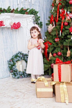 decorates: little girl decorates a Christmas Christmas tree Stock Photo