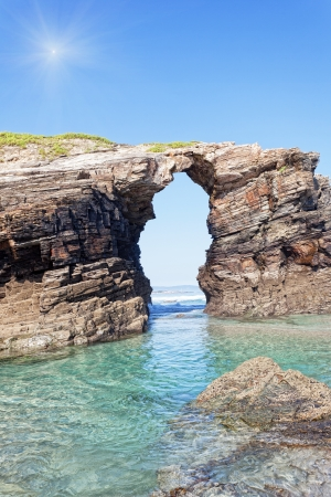 stone arches: Stone arches on Playa de las Catedrales during outflow, Spain