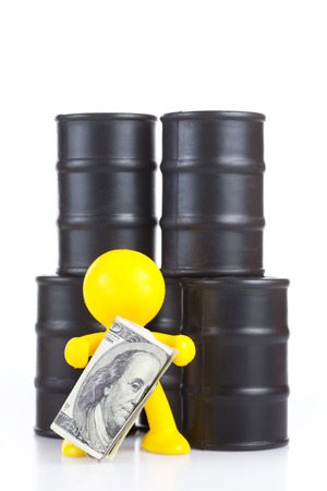 supremacy: toy little man stand at butts with oil and holds many money  The world supremacy concept oil-extracting the companies
