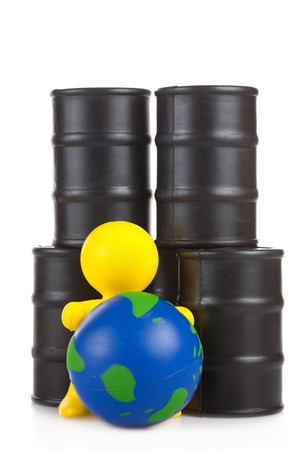 supremacy: toy  little man sits next on butts to oil the globe. The world supremacy concept oil-extracting the companies
