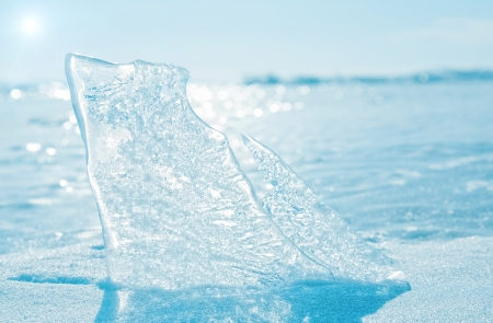 Transparent ice with cracks as a background for design photo