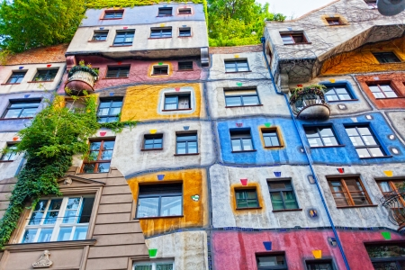 finest: VIENNA, AUSTRIA - JULY 26: Hundertwasser Haus on July 26, 2013 in Vienna. The iconic building was finished in 1985 and is one of finest examples of expressionist architecture.