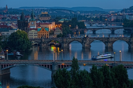 View of Prague at night: river Vltava and bridges photo