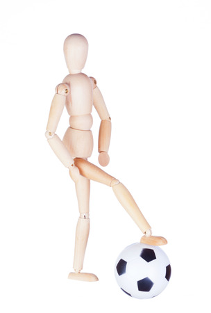 motionless: Wooden figure of the little man with a soccerball