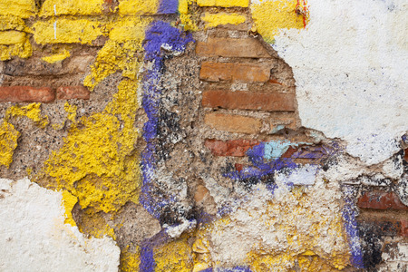 peeledoff: Old brick wall with the peeled-off color plaster as a background