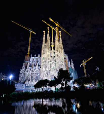 uncomplete: BARCELONA - SEPTEMBER 29: The Basilica of La Sagrada Familia at night. Designed by Antoni Gaudi, its construction began in 1882 and is not finished yet on September 29, 2013 in Barcelona, Spain. Editorial