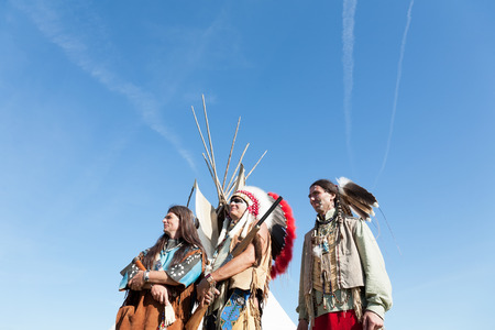 Group of North American Indians against the blue sky photo