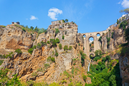 Puente Nuevo (new bridge) and houses on the edge of an abyss in the city Rhonda, Spain photo