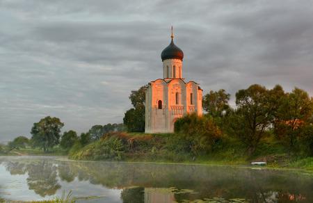 intercession: Morning fog over a pond near the temple of the Intercession on Nerli, Bogolyubovo
