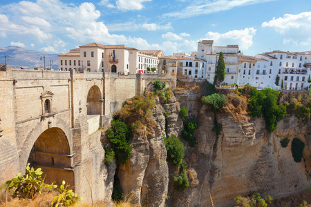 new bridge and houses on the edge of an abyss in the city Rhonda, Spain photo