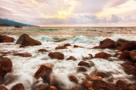 inflow: Big boulders and sea waves at sunrise