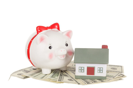 economic rent: Pig moneybox, cash and house. Concept of accumulation of money for purchase or rent