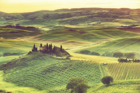 san quirico: Sunrise over the rural house with vineyards in San Quirico dOrcia, Tuscany, Italy Stock Photo