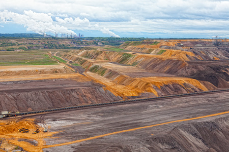 dragline: Bucket-wheel excavator in an open pit. landscape with extractive industry