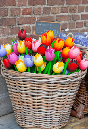 without windows: Big basket with tulips - traditional souvenirs from Holland - at shop doors Stock Photo