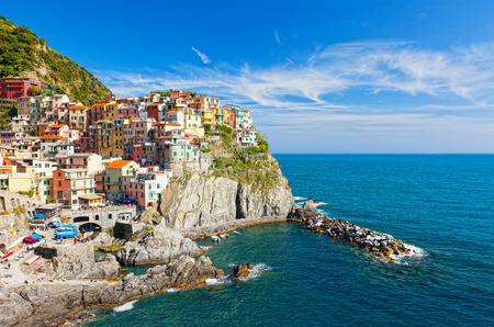 Manarola village on cliff rocks and sea at sunset., Seascape in Five lands, Cinque Terre National Park, Liguria Italy Europe. Stock Photo