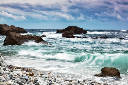 inflow: Beautiful sea landscape with waves and the cloudy sky Stock Photo