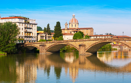 river arno: Florence, bridge through the river Arno is reflected in water