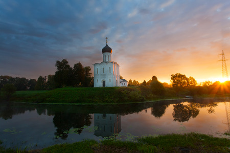 intercession: Beautiful sunrise over Church of the Intercession of the Holy Virgin on Nerl River, Bogolyubovo, Russia Stock Photo