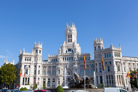 noticeable: SPAIN, MADRID - SEPTEMBER 24, 2013:Palacio de Comunicaciones.Palace of communication — the most noticeable construction on the square of plaza de Cibeles in historic center of Madrid.