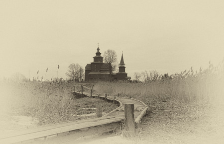 evangelist: Old wooden Church of St. John the Evangelist on Ishna - the river (1689), Russia. Stylization under a retrocard Stock Photo