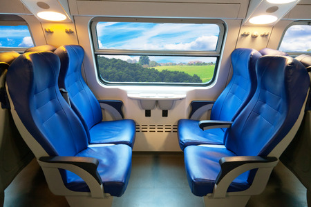 car of the train of the long-distance message with a beautiful view from the window 스톡 콘텐츠