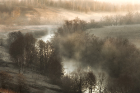 surreal landscape: Surreal landscape with a river mist at sunrise in the early spring Stock Photo