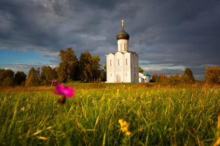 nerl river: Reserved meadow near Church of the Intercession of the Holy Virgin on the Nerl River before a rain