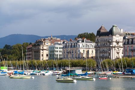 uptown: GENEVA,SWITZERLAND - SEPTEMBER 10: Yachts on the lake, Geneva, Switzerland, September 10, 2013. The lake Lehman - the biggest lake of the Alps
