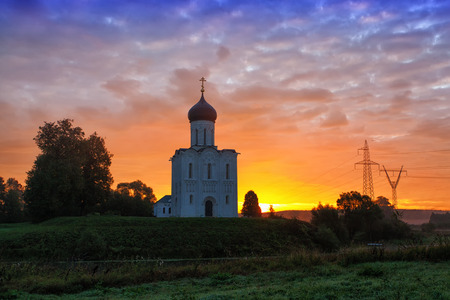 nerl: Beautiful sunrise over Church of the Intercession of the Holy Virgin on Nerl River, Bogolyubovo, Russia Stock Photo