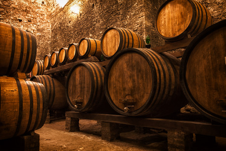 cellar with barrels for storage of wine, Italy Stock Photo