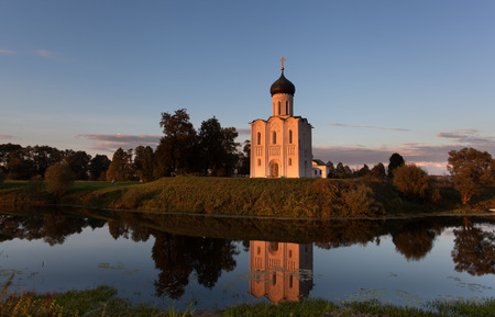 nerl river: Church of the Intercession of the Holy Virgin on the Nerl River lit with the sun on a sunset in autumn day Russia