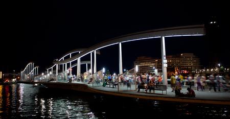 rambla: BARCELONA , SPAIN - SEPTEMBER, 28, 2013. Marina Port Vell and the Rambla del Mar in Barcelona . The Ramla del Mar is a main attraction in Barcelona. Editorial