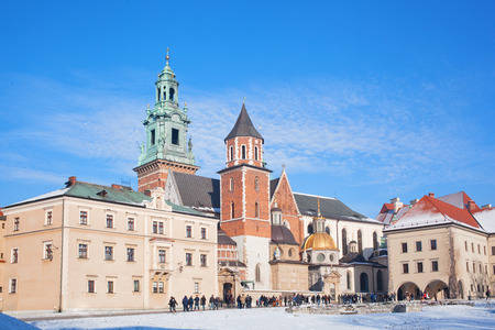 wawel: POLAND, KRAKOW - DECEMBER 31,2014:Tourists in the territory of the Wawel castle. Wawel - the hill and an architectural complex in Krakow, on the left coast of Vistula. Editorial