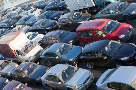 exceeds: MOSCOW,RUSSIA - FEB.02, 2012: Big transport stopper. Road jams arise because of a large number of transport which exceeds the maximum capacity of roads in the city