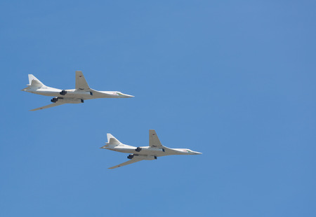 supersonic: RUSSIA, MOSCOW - MAY 7, 2015: The supersonic strategic Tu-160 bombers  (White swan) in the sky on rehearsal of parade of the Victory. Editorial