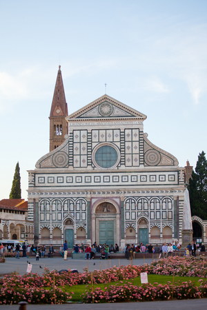 lasted: ITALY, FLORENCE - MAY 9, 2014: Tourists near Basilica di Santa Maria Novella. Its construction began in 1246 and lasted to the middle of the XIV century.