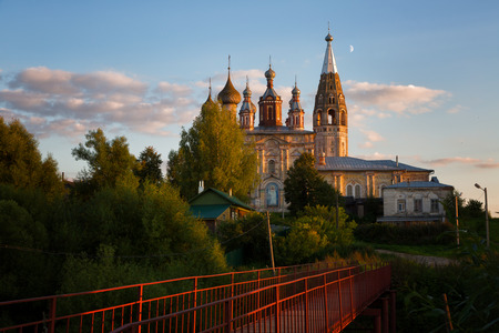 evening church: Rural evening landscape with the bridge and old stone church, Russia