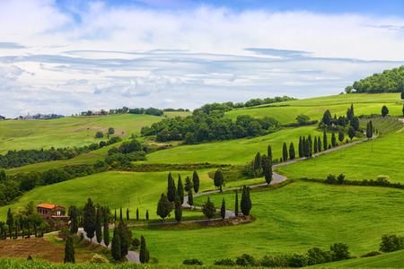 twisting: Beautiful landscape of Tuscany with the twisting road and cypresses Stock Photo