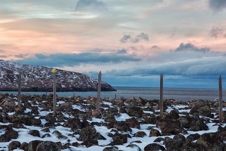 arctic zone: Former border area on the coast of the Barents Sea in Teriberka, Russia Stock Photo
