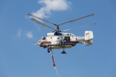 situations: RUSSIA, NOGINSK - AUGUST 7, 2015: The helicopter Kamov 32A in the sky on doctrines of rescuers of Ministry of Emergency Situations of Russia. Editorial