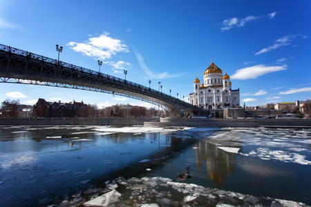 patriarchal: Moscow, Christ the Savior Cathedral and Patriarchal Bridge on a sunny spring day during an ice drift on the Moscow River