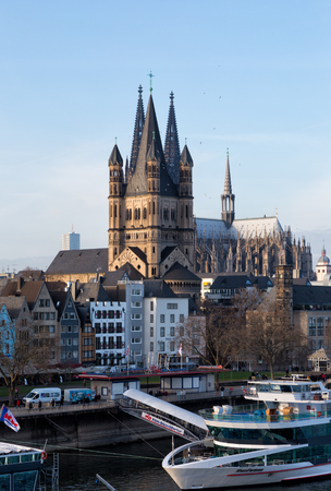 rhine westphalia: GERMANY, COLOGNE - JANUARY 1, 2016: Rhine Embankment and Saint Martins cathedral. Cologne is the fourth on the population and the city of Germany, the third on the area.