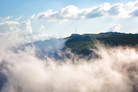 below: Clouds move below rocks on the mountain Ai Petri,  Crimea Stock Photo